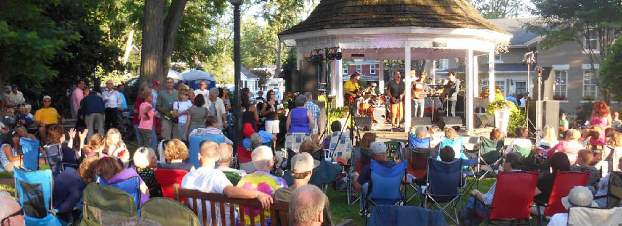 Band Playing in a Gazebo with Crowd
