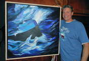 Man Standing next to a Painting of SS Edmund Fitzgerald