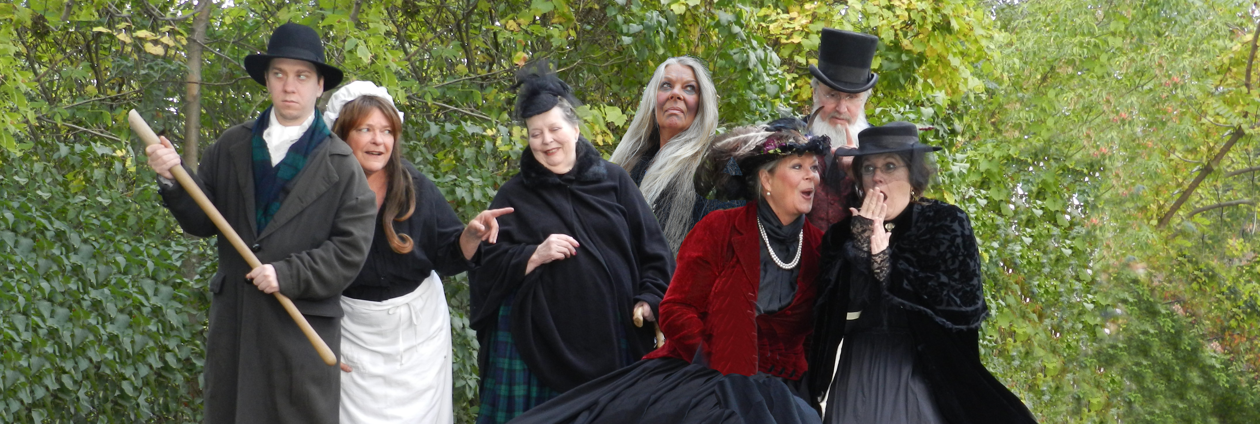 People in Costumes with Trees in Background